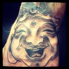 buddha hand tattoo laughing buddha tattoo on chest photo 3 photo pictures and