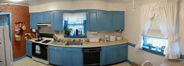luxury l shape kitchen with blue wall paint color with brown