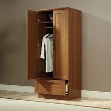 sauder select storage cabinet in white wardrobes sauder beginnings wardrobe storage cabinet in cinnamon