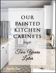 how to paint my kitchen cabinets white painted kitchen cabinets how they are holding up 2 years