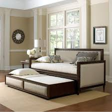 fashion bed group s grandover upholstered daybed has cream fabric fashion bed group s grandover upholstered daybed has cream fabric framed with espresso wood and brass nailhead
