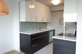 kitchen cabinets black kitchen cabinets grey walls wooden spoon