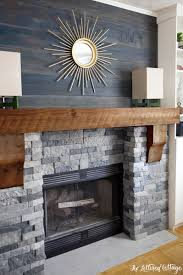 interior living room architecture fireplace stone wall modern