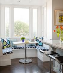 small kitchen nook deisgn at corner wth white and black furniture
