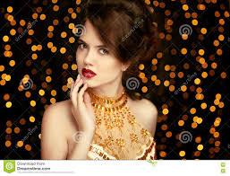 beauty makeup fashion jewelry elegant lady in golden dress