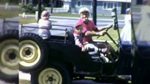 small jeep for kids 1960s happy granddad grandkids riding unsafe no seatbelts kids