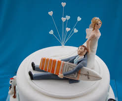 bride and groom wedding cake topper surfing cake price 350