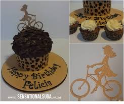 leopard print giant chocolate ganache cupcake with gold cyclist