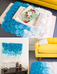 Hanging Rugs On A Wall A Pom Pom Rug Wall Hanging And Table Cover In One Brit Co