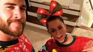 miley cyrus and liam hemsworth rock ugly christmas sweaters for