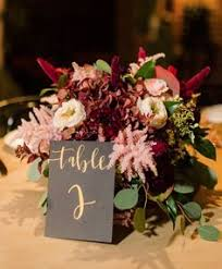 gold and purple wedding flowers and decor table decor mercury