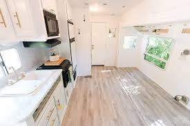 can i put cabinets on vinyl plank flooring installing vinyl plank in an rv with a pull out our diy