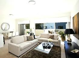 living room white couch brown rugs for living room rugs design