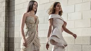 la reina exchange wear a new designer dress to every special