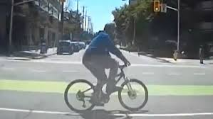 red light ticket video cyclist sent flying by car gets a ticket for running a red light