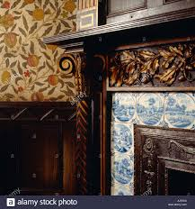 a detailed close up of the corner of the fireplace in the library