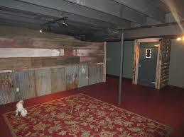 flat black ceiling brick red painted floor and amazing barnwood