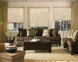 modern black fabric sofa and black wooden rectangular coffee table