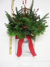 White Christmas Flower Decorations by Christmas Arrangements Assorted Greenery Arrangements