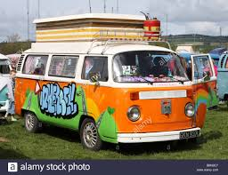 orange volkswagen van orange and white vw camper van stock photo royalty free image