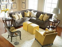 Yellow Living Room Ideas grey and yellow living room stone fireplace chocolate couch wooden