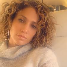 women curly haircuts for latina look jennifer lopez shows off her short curly hair short