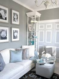 grey wall and cream fabric sofa on blue carpet connected by cream