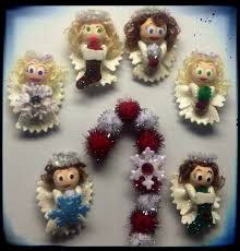 i created these angel candy cane pins and magnets using elbow and