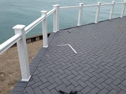 outdoor living low sloped roof decks composite pavers and cable