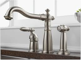venetian delta pull out kitchen faucet wide spread two handle side