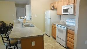 Small Kitchen Appliances Garage With Tiled Backsplash by Kitchen Dazzling Small Displaying Wooden Bar Table With Kitchen