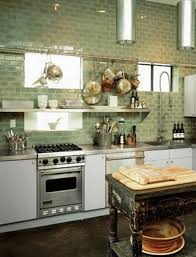 stylish green colored backsplash with floating shelves for small
