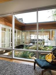Interior Designs Of Homes The Center Atrium Deflects Natural Light To All Four Corners Of