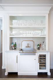 Apron Sink With Backsplash by Chic Wet Bar Boasts White Cabinets Fitted With A Metal Apron Sink