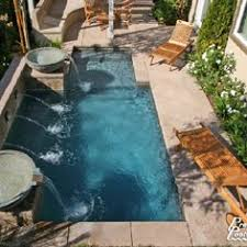Backyard Pool Images by Narrow Pool With Tub Firepit Great For Small Spaces In