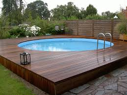 modern swimming pool with wooden and concrete deck three types