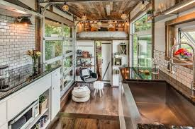luxurious alpha tiny house opens wide on both sides to let the