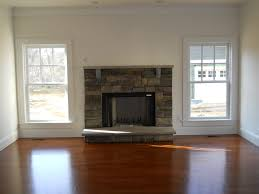 Beautiful Fireplaces by A Beautiful Stone Fireplace Is Added In The Home U0027s Living Room