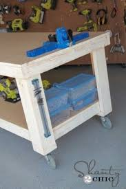 Diy Workbench Free Plans Diy Workbench Workbench Plans And Spaces by A Simple Diy Workbench That U0027s Perfect For Any Garage Or Workspace