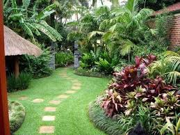 Small Tropical Garden Ideas Brick Wall And Tropical Plants For Backyard Landscaping