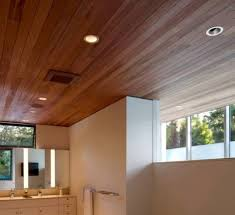 modern bathroom with wooden ceiling and recessed lighting