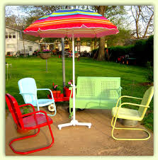 Old Fashioned Metal Outdoor Chairs by Vintage Umbrella Stand Surrounded By 1940 U0027s U0026 50 U0027s Metal Lawn
