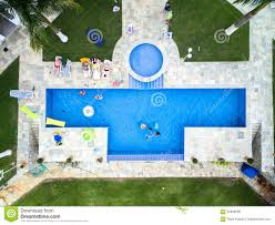 top view of people enjoying the swimming pool stock photo image