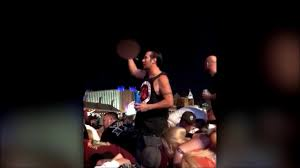 during shooting in lasvegas a man holding a beer stood up