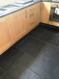black tile floor kitchen homes design inspiration