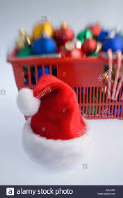 shopping basket filled with colorful tree bulb ornaments