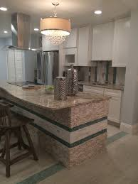 standing quartz pebble tile kitchen island and backsplash pebble