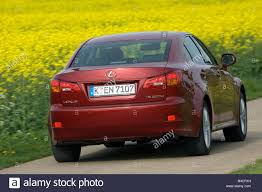 red lexus lexus is 220d model year 2006 red driving diagonal from the