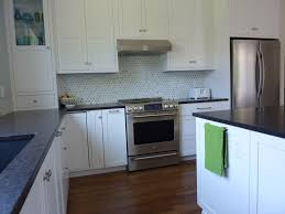 kitchen backsplash with stainless steel cost of solid surface