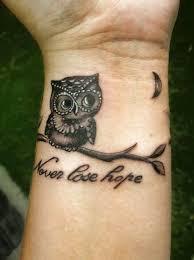 tattoo girl owl nice hope letters amazing owl tattoo on girl wrist golfian com